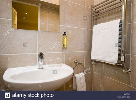 Bathroom Sink With Wall Mounted Soap Dispenser And Towel