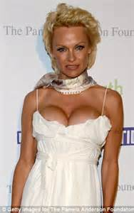 Pamela Anderson swaps pixie cut for long extensions as she