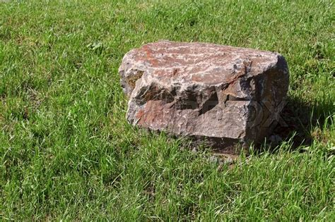 large slab among the green grass stock photo