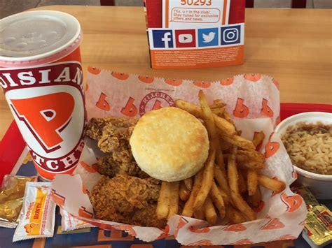 piece cajun wing dinner  fries red beans  rice biscuit   ice tea