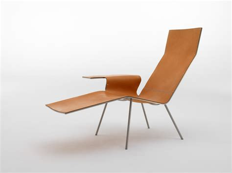 stylish leather chaise lounge chair with single arm and
