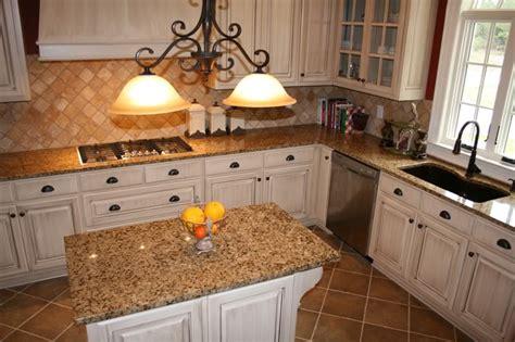 cream backsplash with white cabinets white cabinets with brown granite help with granite for