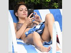 Katharine McPhee showcases her bikini body poolside in