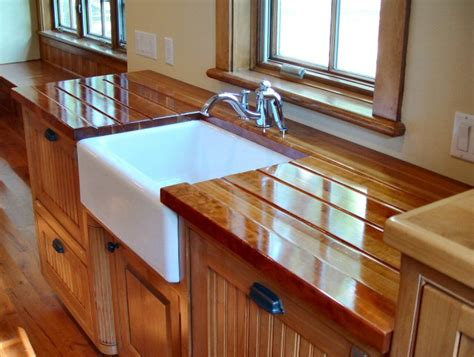 butcher board countertop cherry face grain countertop with under mount farm sink and integrated sloping drain boards