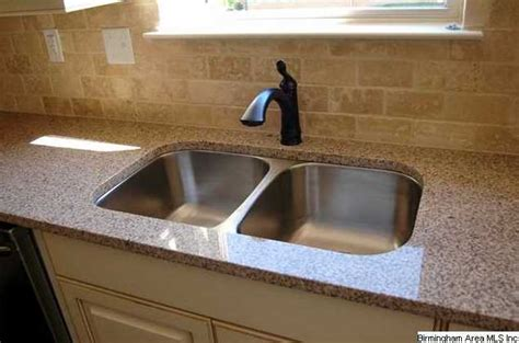 kitchen also features granite undermount sink and