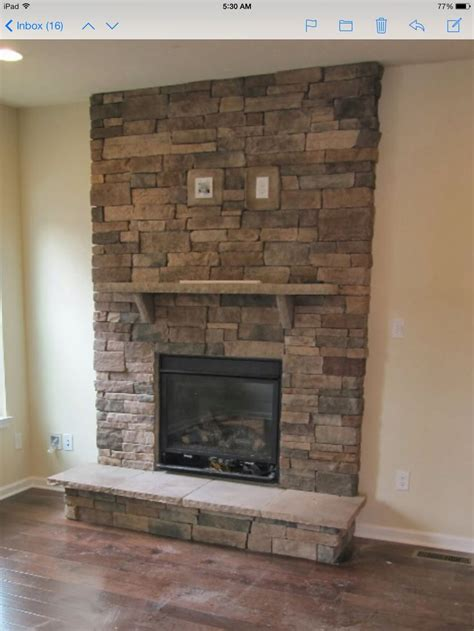 stacked stone fireplace  tv mount stacked stone