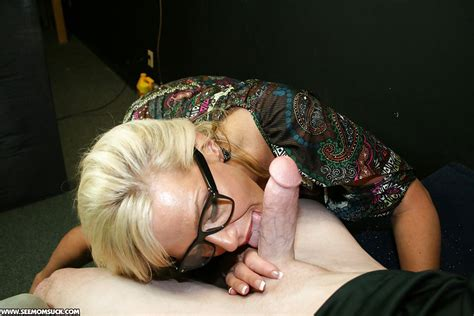 Mature Blonde In Glasses Sucks A Big Cock And Gets A