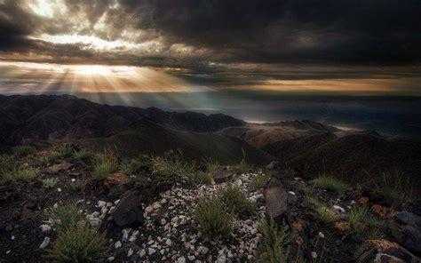 nature landscape sun rays mountain shrubs dark
