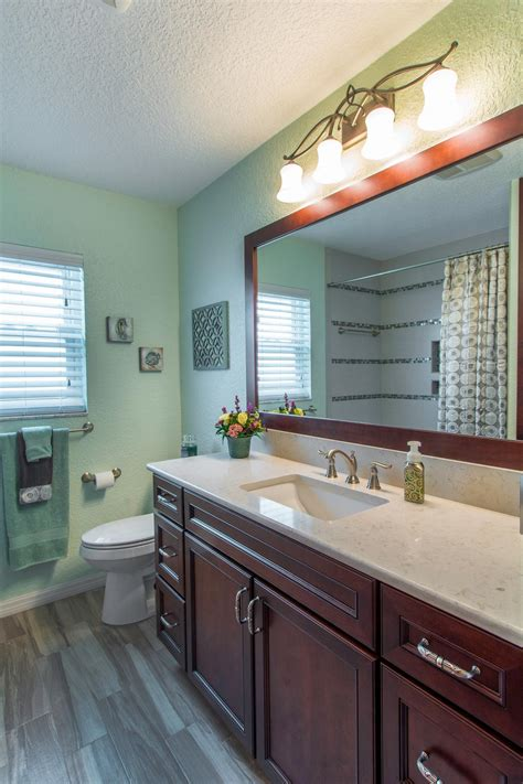 green transitional style bathroom  wood vanity