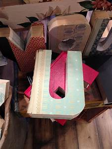letters and numbers cut out of old readers digest books With books cut out into letters
