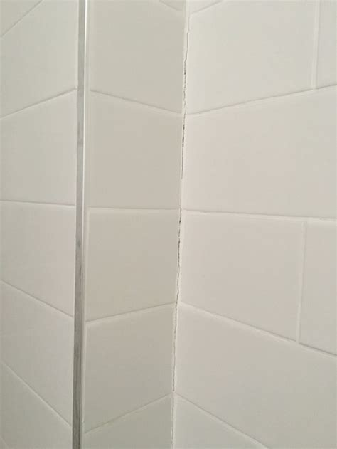 tile inside corners grout or caulk grout cracking in shower corners