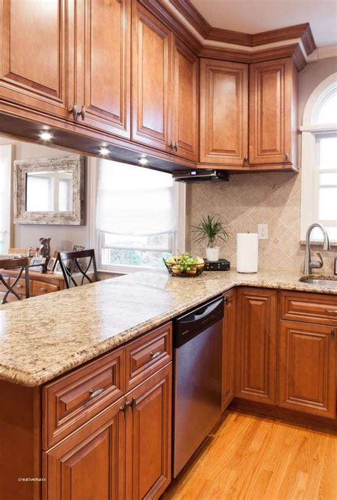 white marble countertops  maple cabinets inspirational