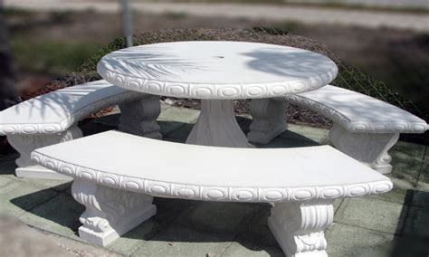 white outdoor benches round concrete table and benches
