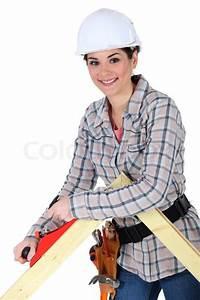 Female Carpenter Using A Planer