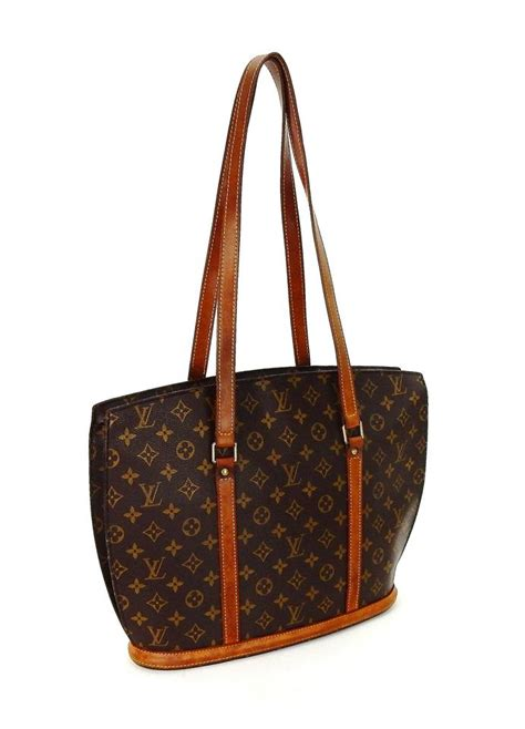 louis vuitton babylone carry  bown monogram canvas