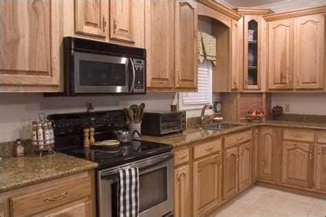 here 39 s a modern kitchen with hickory cabinetry and granite