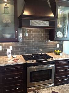 Ice gray glass subway tile dark brown cabinets subway for Dark gray kitchen backsplash