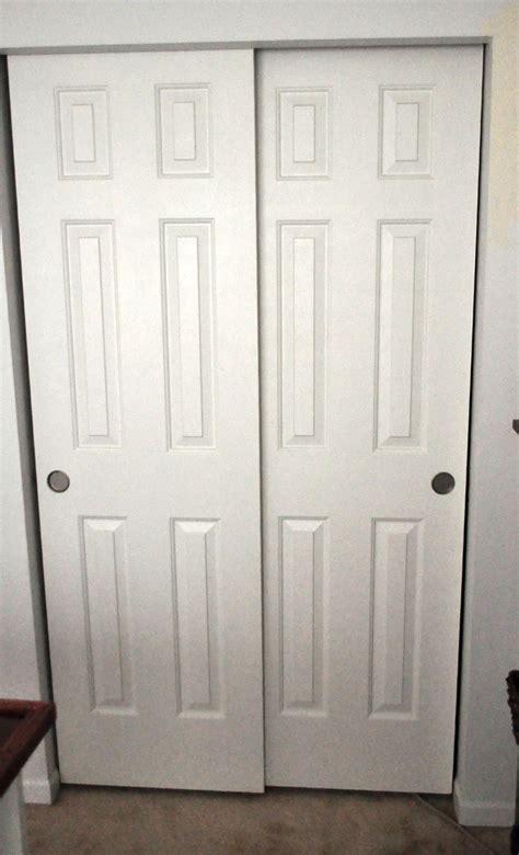 wood bypass closet doors home design ideas