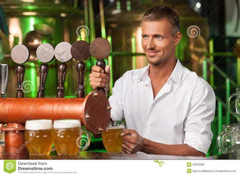 bartender serving beer handsome bartender  white shirt