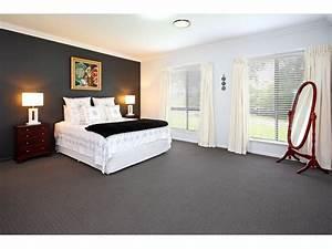 Modern bedroom design idea with carpet bi fold windows for Bedroom carpet colours