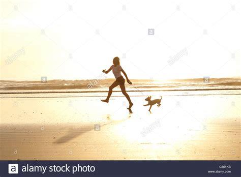 girl running   beach   dog   morning