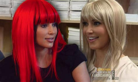 Kim Kardashian dons an array of wigs as she struggles to ...
