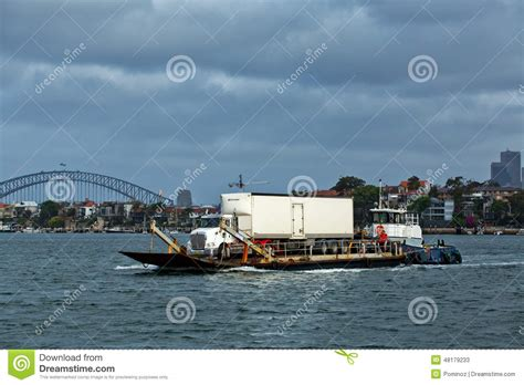 Tug Boat Jobs Australia by Truck On Barge Is Pushed By Tug Boat Editorial Stock Photo