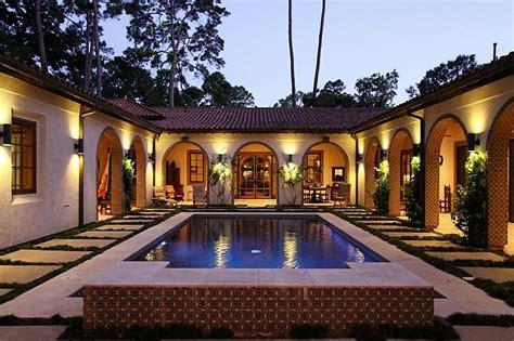 gorgeous  courtyard pool  wrap  verandas hacienda style homes spanish style homes