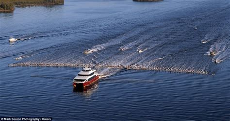 Biggest Wakeboard Boat In The World by Water Skiing World Record 145 Water Skiers Pulled Behind