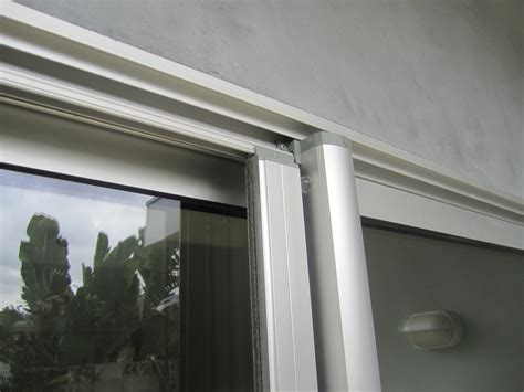 encino installation of clear anodized retractable screen