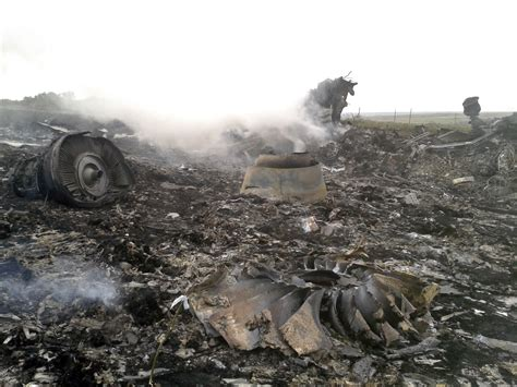 Graphic Photos Show Wreckage Of Malaysia Airlines Crash In