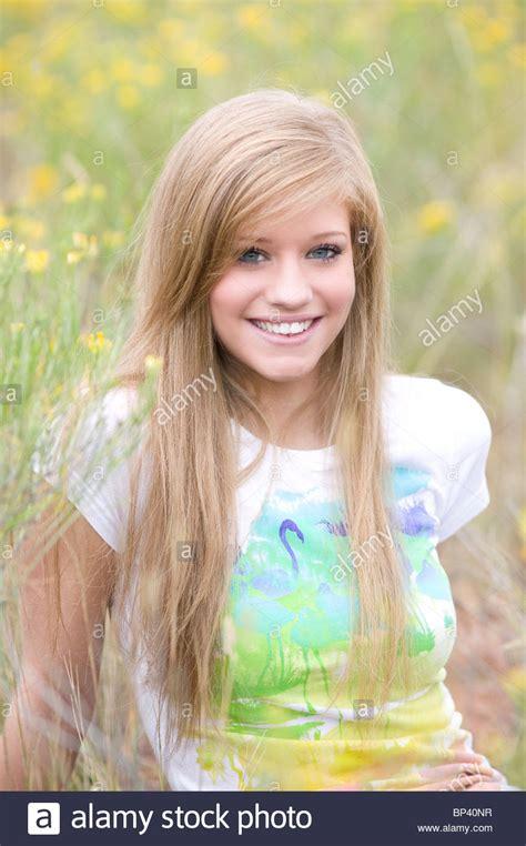Portrait Of Teenage Girl 17 18 Years Old Sitting In Field
