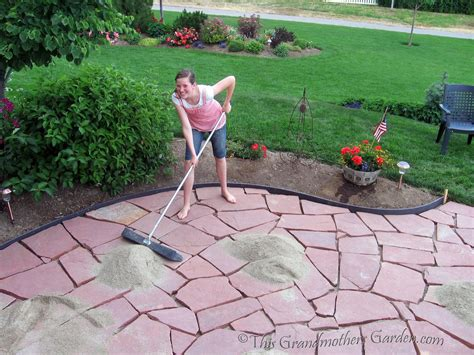 how to make a flagstone patio this grandmother s garden filling in the gaps part 3 of our diy flagstone patio