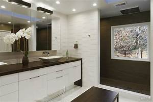 Modern white bathroom with textured tiles, shower zone and ...