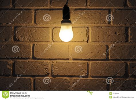 light bulb and brick wall royalty free image