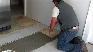 How to install ceramic tiles on a floor youtube for Can you put a tv in the bathroom