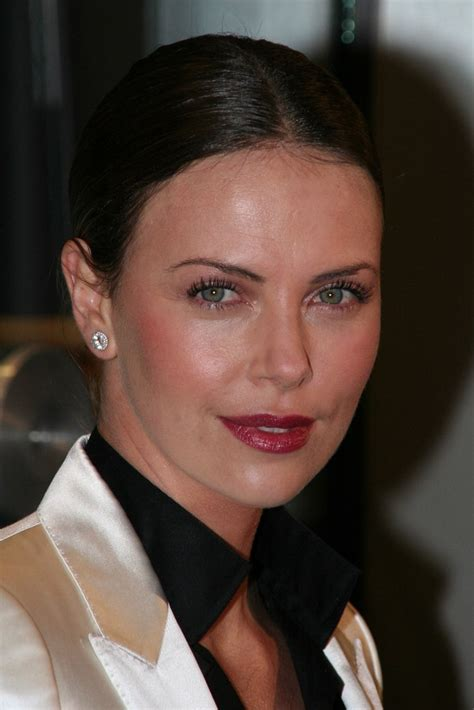 charlize theron hair   severely brushed  style