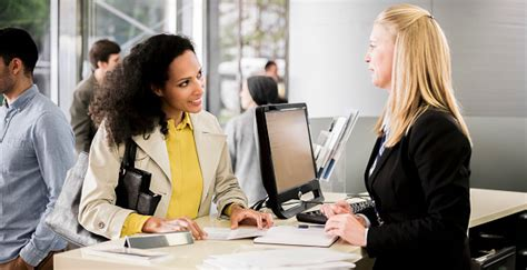 If you have a new bank account. Female bank teller advising female customer - Sandhills Community College
