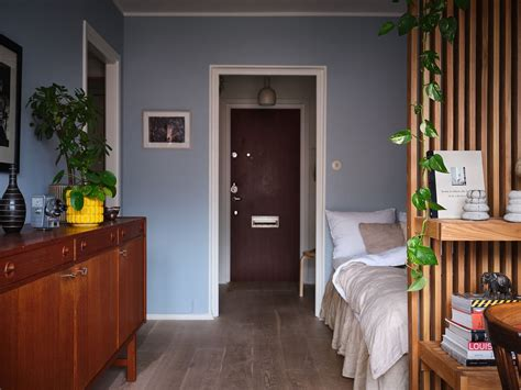 a tiny but stylish blue studio apartment the nordroom in