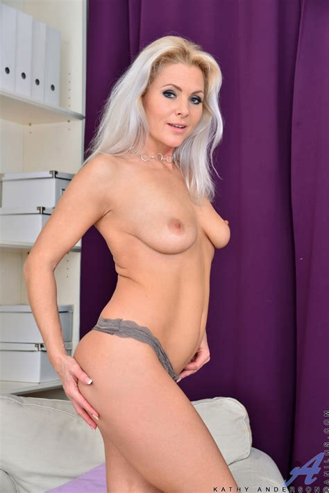 older milf kathy anderson toys her twat after wiggling out of a skirt