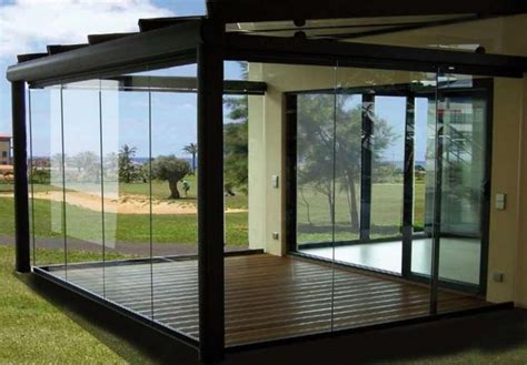 glass patio enclosure overhang from house providing