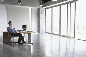 Man Sitting At Desk In Empty Office Stock Photo - Image of ...