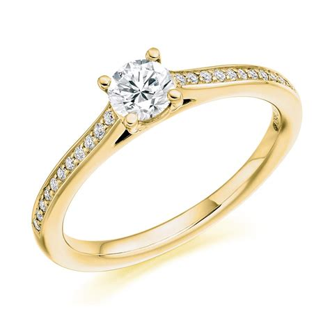18ct yellow gold solitaire with diamond set shoulders