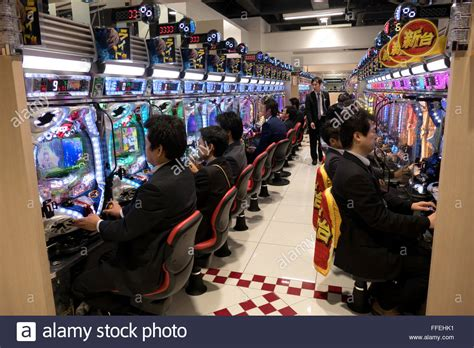 Japanese People Playing Pachinko Lottery Arcade Game