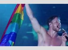 Imagine Dragons singer Dan Reynolds waves Pride flag at