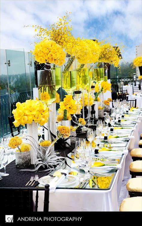 yellow black and white table setting oncidiums roses callas pincushion protea celosia