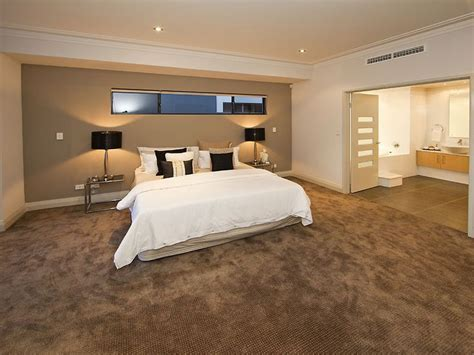 modern bedroom design idea  carpet french doors  brown colours bedroom photo
