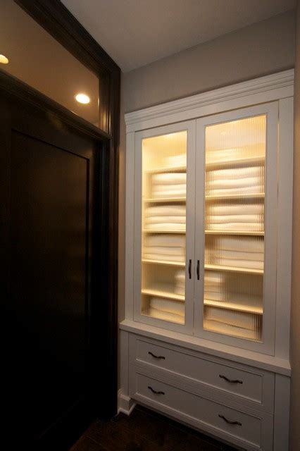 robeson design built  hallway closet towel storage