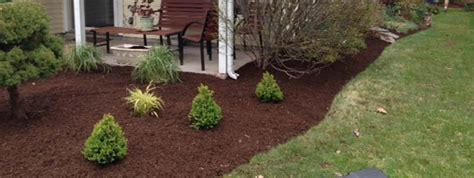 mulching beds flower beds with mulch