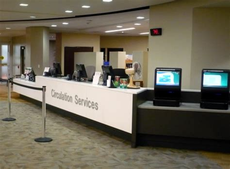 circulation desk  level college  dupage library